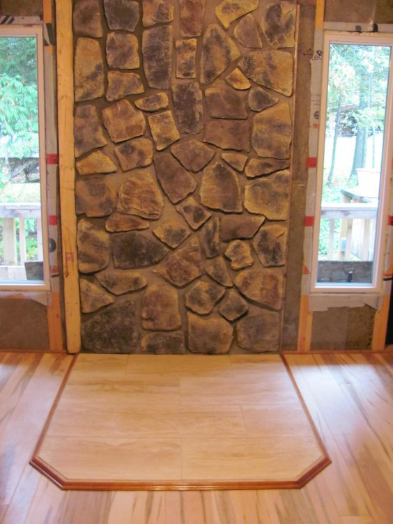 Best ideas about DIY Stone Wall Behind Wood Stove . Save or Pin Stone wall behind woodstove and new windows flanking wood Now.