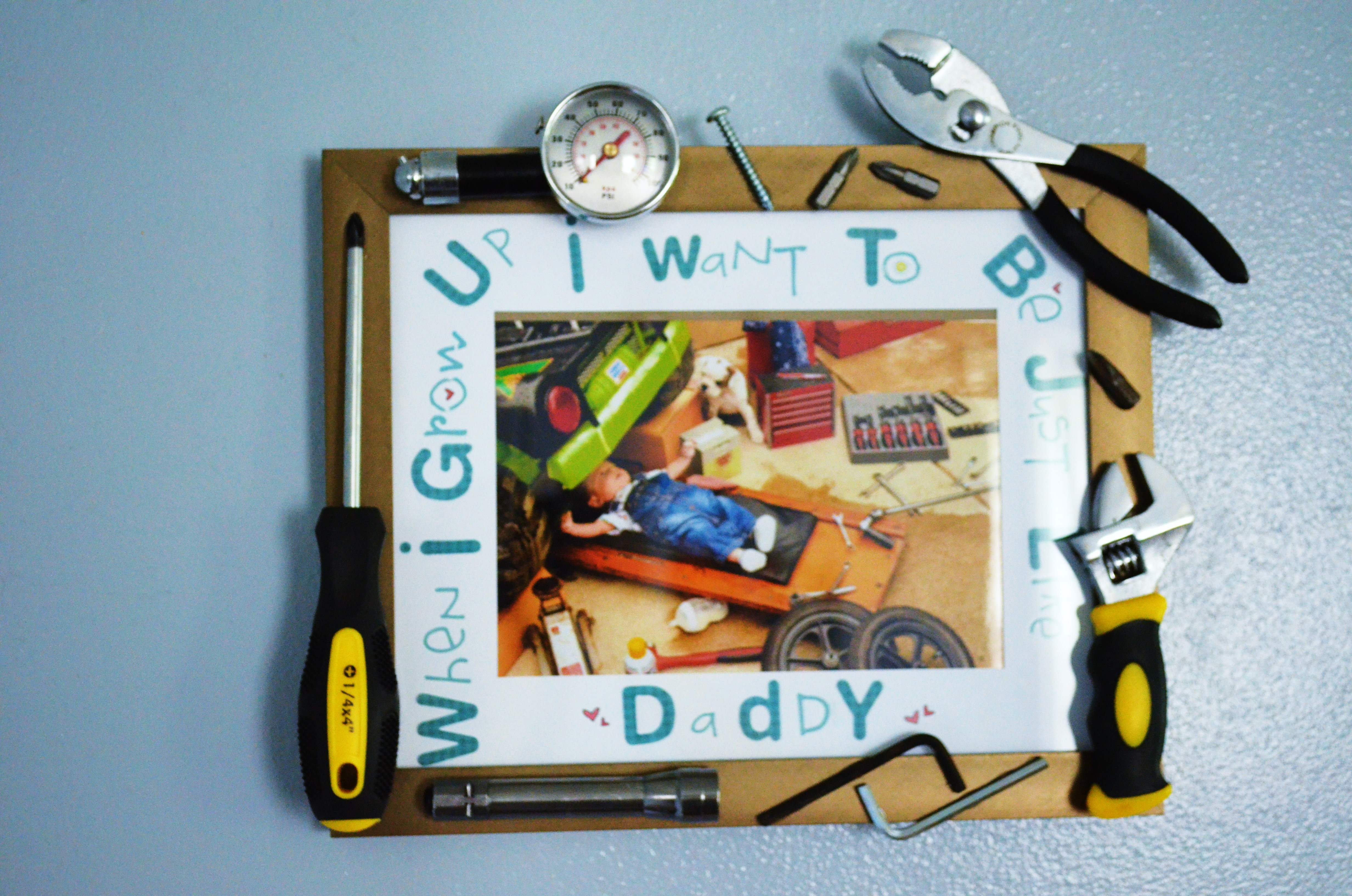Best ideas about Father'S Day Gift Ideas From Baby . Save or Pin Fathers Day DIY Baby Mechanic Tool Frame Project Nursery Now.