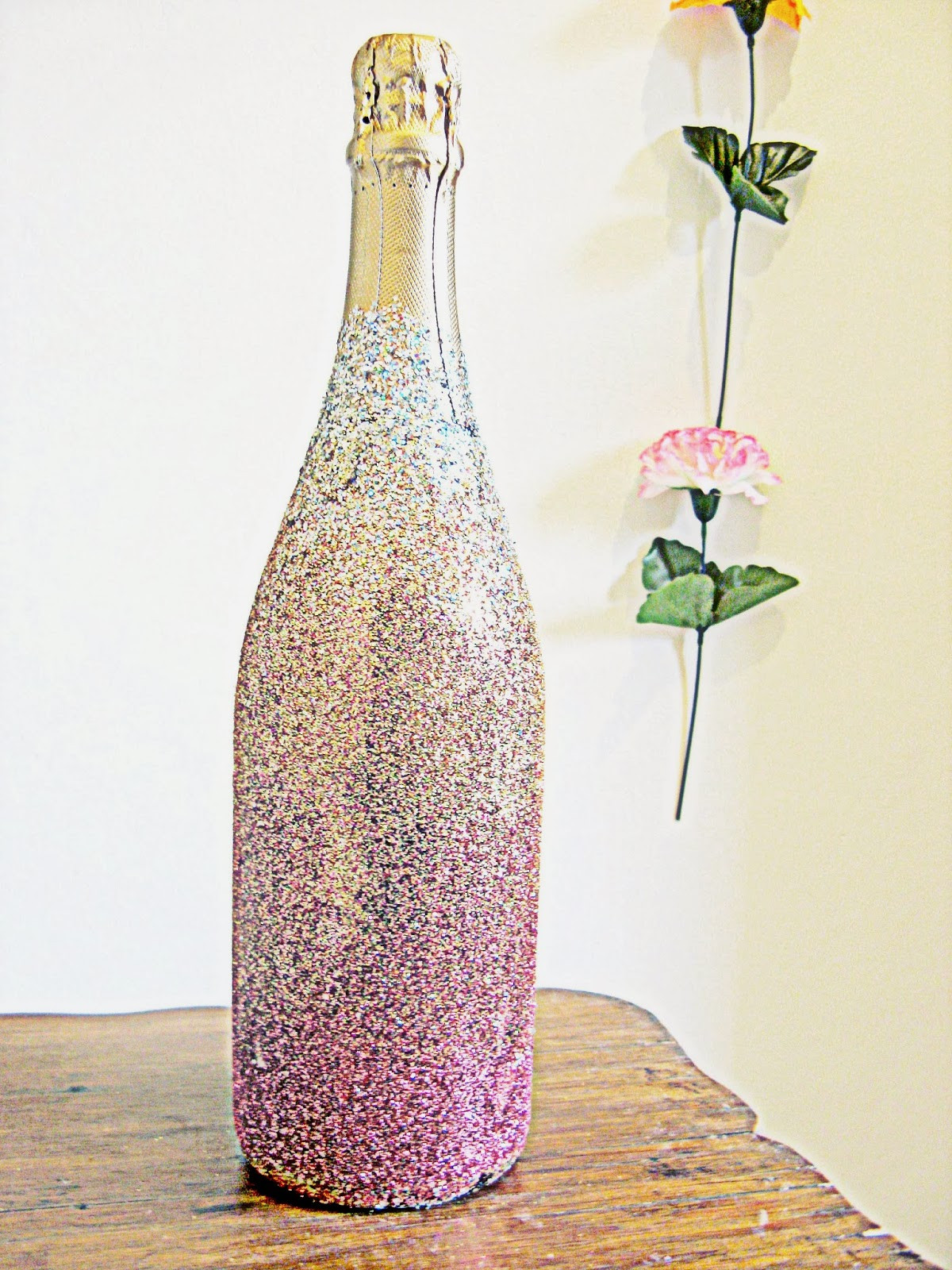 Best ideas about Glitter Wine Bottles DIY . Save or Pin Hunted and Made DIY Ombre Glitter Champagne Bottle How Now.