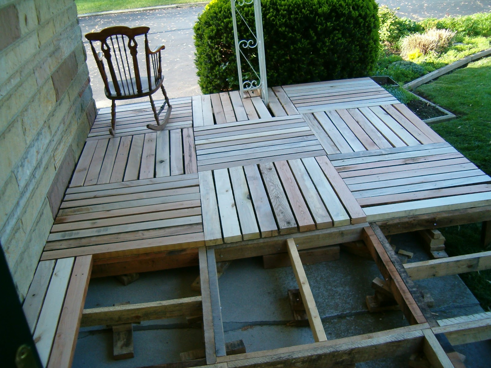 Best ideas about Pallet Decking DIY . Save or Pin Redo Redux Revisiting Past Projects Pallet Wood Front Porch Now.